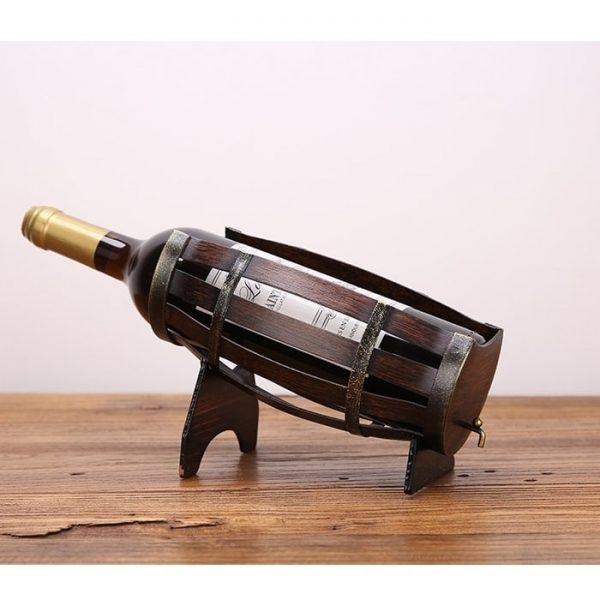 Porte bouteille en fer ancien en forme de baril